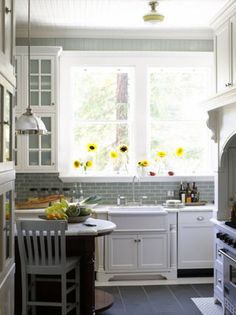 white cabinets + gray backsplash + yellow accents = happiness