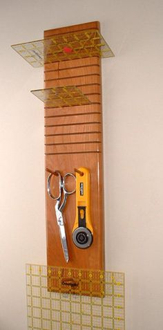 Quilter's Hanging Ruler Rack, 14 slots, Cherry. $24.95, via Etsy. - pretty sweet, and looks pretty easy to make.