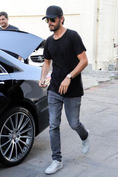 Scott Disick wearing Saint Laurent Original Low Waisted Skinny Jean in Washed Grey Stretch Denim, Ray-Ban Original Aviators, John Elliott Mercer T-Shirt and Common Projects Original Achilles Leather Sneakers in Light Grey