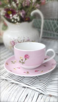 Tea for me. Dainty feminine cup and saucer with hand picked flowers in a jug.