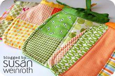 Adorable handmade bibs in fall colors!  Great for protecting clothes from stray cupcake bits! #pamperspinparty