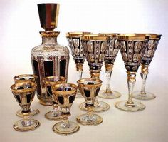 A Moser glass and decanter set early century. Five wine glasses, five liqueur glasses plus decanter with stopper, in clear and ruby glass having gilt highlights Carafe, Cut Glass, Glass Art, Cristal Art, Cranberry Glass, Crystal Glassware, Drinking Glass, Carnival Glass, Antique Glass
