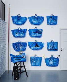 An inexpensive, easy storage wall that uses 11 IKEA blue bags