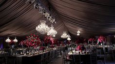 Tent wedding featuring 17 chandeliers by SignatureChandeliers.com #platinumwedding #tentwedding