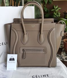 Celine Micro Luggage Bag in Souris (I want this so bad :( )  I love the version with pink stitching throughout it, I've seen it somewhere, but it's probably limited edition from somewhere?