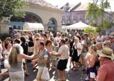 French Market Creole Tomato Festival. June in New Orleans means the arrival of Creole tomato dishes on local restaurant menus, in farmers markets and at roadside stands.