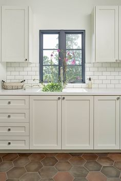 White kitchen design with honey comb tiled flooring | Park and Pacific Design