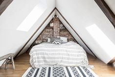 Attic bedroom with exposed brick