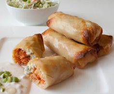 Baked Buffalo Chicken Rolls--shredded chicken, Frank's Red Hot sauce, blue cheese, and broccoli slaw in an egg roll wrapper