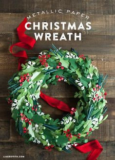 There is nothing that says Christmas better than the traditional red and green color mix. This gorgeous paper Christmas wreath is something you can make and decorate with year after year as it will always me a handcrafted treasure. The wreath includes holly leaves and berries, mistletoe leaves and berries as pine needles adding a pop of teal. I love this teal green color in the mix as it give the wreath a different texture and color twist as well as coordinating with my deep teal front door.