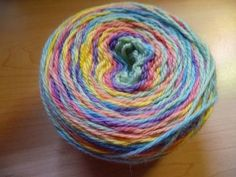 Self-Striping Yarn (with a Warping Board) Tutorial  looks complicated, but if you wanted to have a certain color combo...