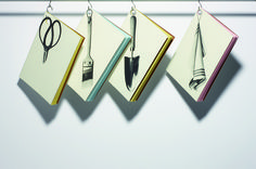 「Your tools」 Distinctive cover designs represent a selection of carpentry, gardening, and kitchen tools, each positioned to hang from a hook. Slim and lightweight notebooks are suitable for note taking or scrapbooks.
