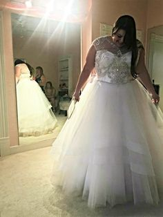 This ornate wedding gown has a bodice that has plenty of bling.  If you are searching for unique #weddingdresses for a bride of any size then this dress shoudl be on your list.  We can make custom #plussizeweddingdresses for you.  But we can also make #inspiredweddingdresses too that will look like the couture original but not cost nearly as much in price.  For more information on custom weddnig gown designs & replicas of couture dresses please go to www.dariuscordell.com