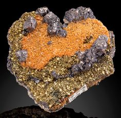 Sphalerite and Siderite on Pyrite and Calcite - Trepca Stan Terg Mine, Trepca complex, Trepca Valley, District of Kosovska Mitrovica, Kosovo