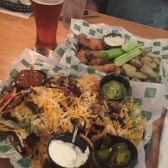 Nachos and garlic wings at Beef O'Brady's in Florida.  Click or visit FabEveryday.com for itinerary, reviews, recommendations, roadside attractions, and good eats for a Southern U.S. family road trip through Texas, Louisiana, Mississippi, Alabama, Florida, Georgia, Tennessee, and Arkansas.