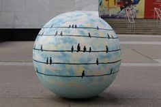 #RealSurreal inspired Frist Bollard by Aaron and Michelle Grayum | In honor of #ArtoberNashville, selected artists adorned the ornamental bollards located at the Frist Center's Turner Courtyard entrance with designs inspired by the exhibitions Real/Surreal and Kandinsky.