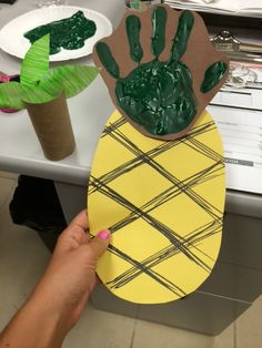 Week of 7/22/14: Toddler Tuesday – Luau Theme! We made handprint pineapples, toilet paper roll palm trees & streamer grass skirts. Pineapple – we painted our hands green & staggered our prints on brown paper, then cut out & drew lines on an oval piece of yellow paper. Palm Tree – we colored 3 pre-cut leaves, then cut 3 slits in the toilet paper roll for each leaf. Grass Skirts – We measured ourselves, then tied colored streamers onto roping. We took a photo in our grass skirts & hula-danced!