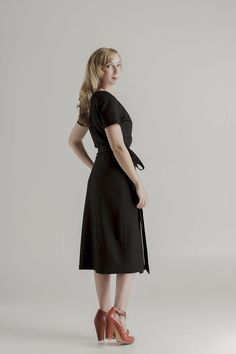 perfectblackdress.com.au Style 1113.  Short-sleeved wrap dress (back view). Super soft winter grade rayon with spandex. Total length 115 cm. Worn beautifully by Claudia (174 cm) in size 10. Available in Australian sizes 8-20.