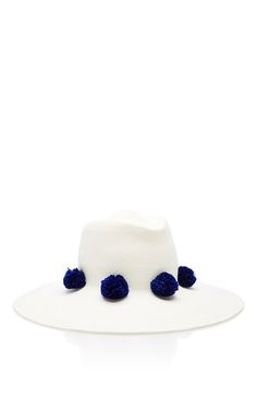 This ** Behida Dolic Millinery** Eva fedora is rendered in panama cotton and features ribbons for tying under the chin or wearing on your back and handmade pom poms.