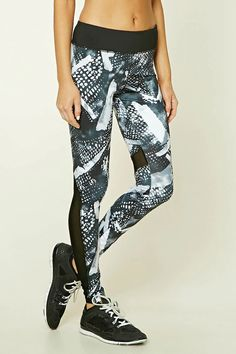 An athletic pair of knit leggings featuring an allover abstract print, a mesh paneling, a hidden key pocket, and moisture management.