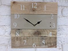 A rustic clock made from Reclaimed Pallet wood with four panels, one panel is painted with Annie Sloan Chalk paint in Country Grey The numbers are stencilled in Times Roman with Annie Sloan Old White This is a large wall clock and measures approximately 36cm square each clock is