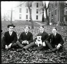 Four men and a dog sit on College Green in autumn, 1890s :: Ohio University Archives