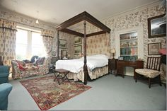 The master bedroom at Hunterston House stands in for the guest room at the B&B.  The only items in this room that remained in the movie were the wallpaper and the carpet.