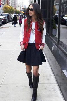 Arielle Noa from Something Navy — Grow Up Your High School Gear    Varsity jackets are the season's most popular topper, but it's easy to look like a teenybopper if you don't wear them right. Keep the rest of your outfit sophisticated (we like Arielle's riding boots and full skirt), and pile on the jewelry.