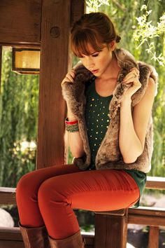 Faux fur vest during Autumn and Winter teamed with a studded teal shirt and pumpkin coloured skinny jeans.
