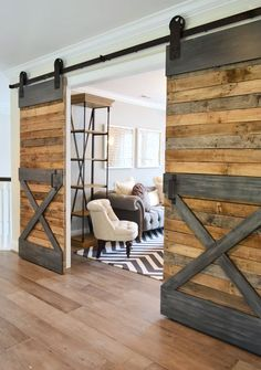 sliding barn doors w/ some boards painted gray to imitate metal trim