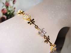 1980s XYPING Gorgeous Clear Crystal Flower and Gold Tone Butterfly Bracelet by CarolsVintageJewelry on Etsy