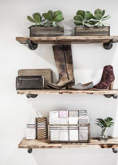 Wooden shelves, succulents, and leather goods