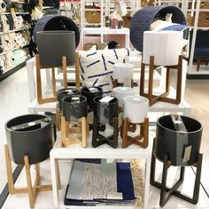 A display at Target of planters on wood stands.