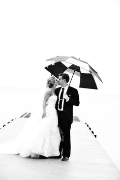 Sealed with a kiss. Photography: Jai Girard Photography - Jaigirard.com  Read More: http://www.stylemepretty.com/2014/06/09/black-white-tented-wedding/