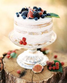 Yum! You absolutely cannot see a photo of this naked berry cake without wanting to taste it! This would be fabulous addition to a outdoorsy summer wedding!