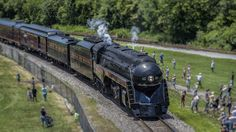 https://flic.kr/p/uoyqS4 | 611 Arriving See Drone | Taken from bridge, see drone over coal  Norfolk & Western No. 611, owned by the Virginia Museum of Transportation, on excursion 13 June 2014, arriving in Petersburg, VA.  Norfolk Southern Railway's 21st Century Steam program is facilitating and supporting excursions.