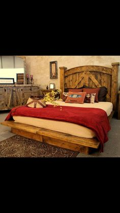 Head and footboard made out of old barn wood. Love the bench footboard.