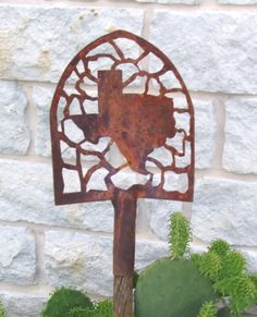 Not crazy about the subject matter, but like the idea of the  cutout in the shovel!  Image detail for -Metal art for Home decor and Garden