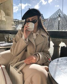 Image may contain: one or more people, people sitting, drink and outdoor Chic Winter Outfits, Winter Chic, Paris Fashion, Winter Fashion, High Fashion, Parisian Chic Style, Mode Ootd, Paris Outfits, Vogue