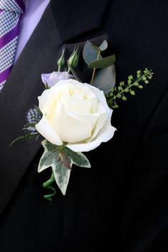 White avalanche rose buttonholes with eryngium and lisianthus