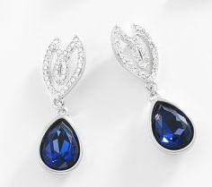 Hermosos pendientes de rodio con piedra de cristal azul topacio. Modelo 415184.