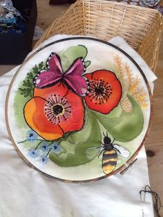 Poppies, cornflower, butterfly and bee. I'm putting the lot onto this small experimental embroidery.