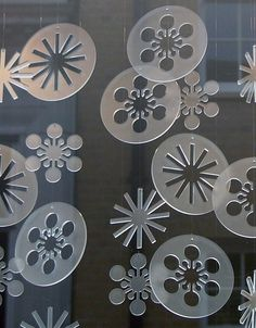 Elizabeth Bone - perspex christmas decorations << #craftylaser #christmas Tip: When cutting snowflakes on the laser, cut a circle around the negative void to make another ornament.