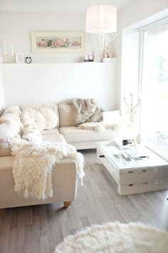 Neutral and serene shabby chic living room. Layer on the pillows, throw blankets and add a hint of color in the artwork...it's all you need to pull off this effortless look.