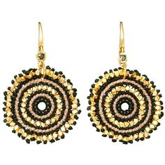 A stunning pair of large calypso drop earrings from Astley Clarke. Alternating bands of gold and black make for a captivating accessory. A small, glimmering st…