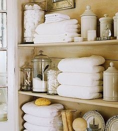 Open shelf bath storage...maybe use glass shelves and maybe glass doors with 'fancy' knobs? where the old linen closet is with bi-fold doors (which ALWAYS get in the way :-/)  and paint inside the shelf walls a light yellow along with the walls in the rest of the bathroom (no windows and using light yellow will help brighten it in there)