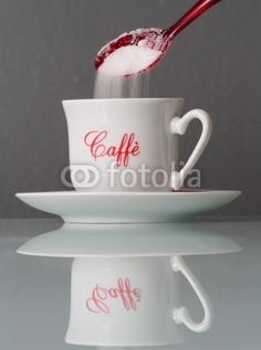 sugar into a cup of coffee - on @Fotolia
