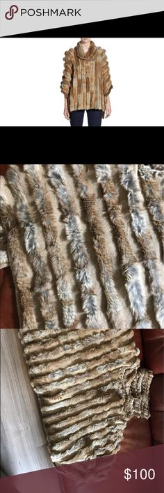 Adrienne Landau rabbit Poncho This Poncho is real rabbit fur and is very comfortable and soft. It is currently retailing on Neiman Marcus for $327. In season similar styles are upwards of $500 at retail. 100% authentic or your money back. Adrienne Landau Other