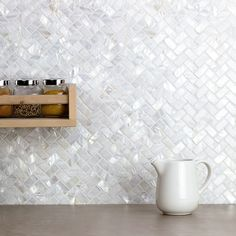 Oyster White Pearl Herringbone Tile from Tile Bar - for bathroom backsplash