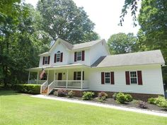Spend your days rocking and swinging on your huge front porch As you enter you are greeted by beautiful hardwood floors large family room with fireplace and formal dining featuring hardwood floors Amazingly upgraded kitchen boasts a SS double oven granite countertops tile backsplash and new floors Second floor is beautiful featuring fresh paint smooth ceilings generous sized bedrooms and a shared bath. The master is a dream with cathedral ceilings and a spa like bath. Fenced yard and more